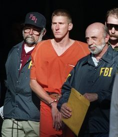 Timothy McVeigh is escorted from the courthouse in Perry, Okla., after he was picked up for not having a license plate on the front of his car. Timoth...