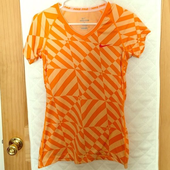Nike women's orange fitted short sleeve shirt Change up your work out wardrobe with this cool orange design fitted t-shirt! Nike Tops Tees - Short Sleeve