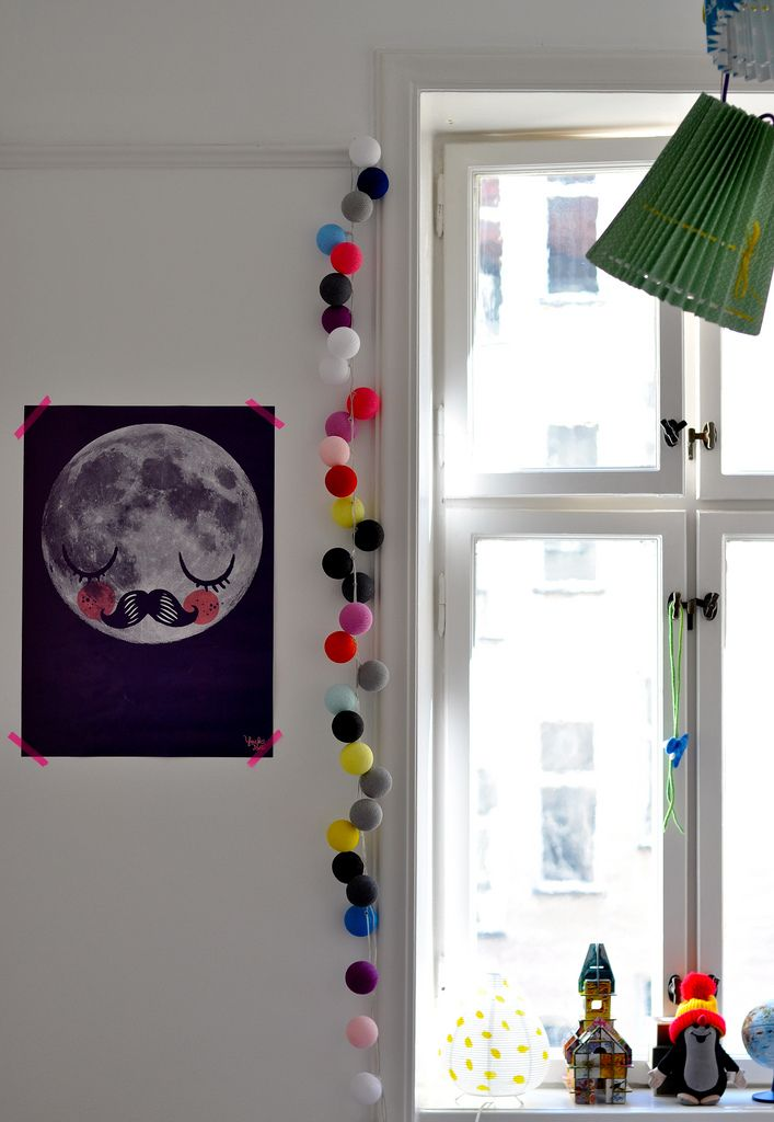 string of cotton ball lights near moon poster