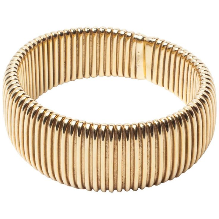 Weingrill Retro Gold Tubogas Flexible Bangle | From a unique collection of vintage retro bracelets at http://www.1stdibs.com/jewelry/bracelets/retro-bracelets/