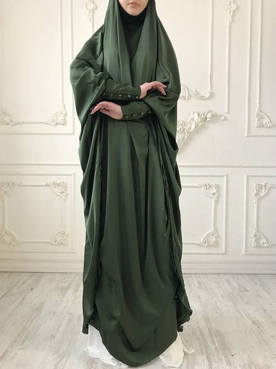 Green khaki silk long khimar with high cuffs. This jilbab will be a good cover for you. Delicate fine silk ideal for summer weather. Always keep in mind that the fabric is enlightened, at the bottom have to be the dress. An elegant way for the believing women. Buttons secure the