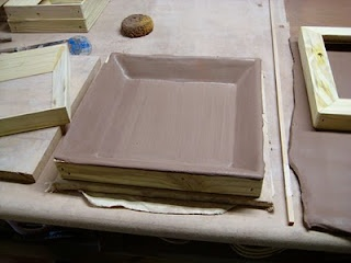 Really need to remember this one!!  Dropped slab of clay on a frame - creates really cool plates and platters...
