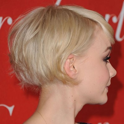 Growing out pixie...keeping back short to avoid a mullet. Carey Mulligan.