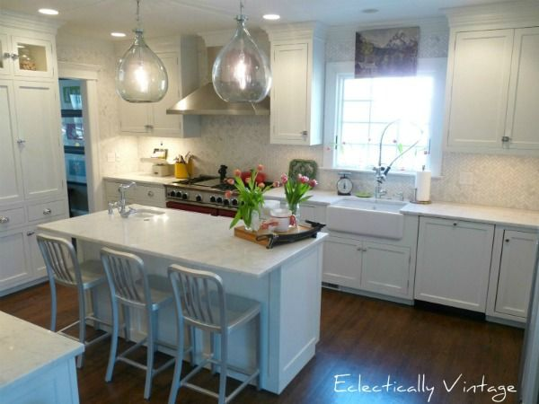 Farmhouse Kitchen - fabulous details like the lighting, backsplash and vintage touches