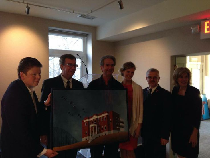 Winner of Andrew King painting posing for photo with Michelle Taggart and guests #Ottawa #Mayor #Wellington #homes