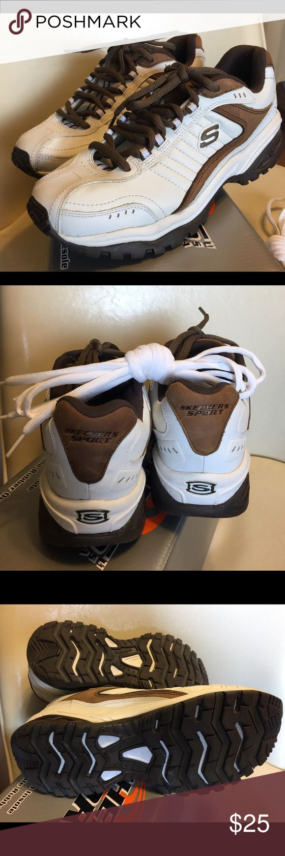 Tennis Shoes Never worn still in box!Skechers Sport men's sneaker. Size 9. Brown and white with matching colored shoelaces. New older model shoes. $25. Skechers Shoes Athletic Shoes