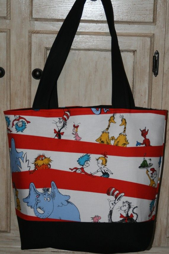 Hey, I found this really awesome Etsy listing at http://www.etsy.com/listing/70963984/dr-seuss-fabric-diaper-tote-bag-cat-in