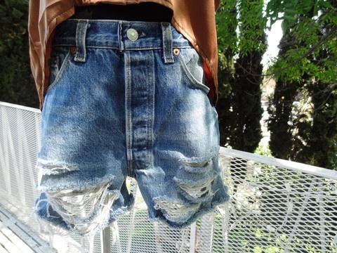 Vintage Levi's shredded shorts $30