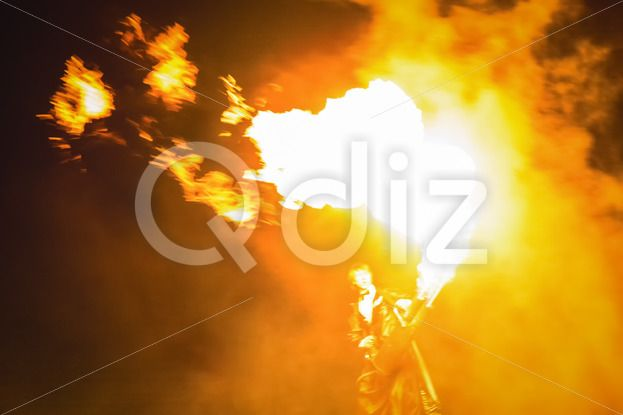 Qdiz Stock Images Fire show,  #action #artist #blaze #blazing #bonfire #burn #burning #danger #demolished #editorial #effect #energy #exploding #explosion #fiery #fire #firebrand #fireshow #firewall #flame #flamethrower #flametongue #flammable #furious #glowing #guitar #heat #hellfire #hot #ignite #illuminated #illustrative #inferno #light #male #man #motion #night #people #perfomance #power #projector #show #smoke #spitfire #swirl #warm #wildfire #yellow
