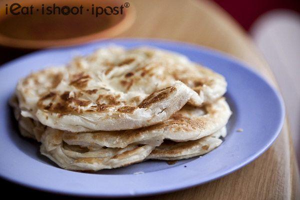 Roti Prata - A pancake-like flat bread that is popular as a breakfast dish in Singapore.