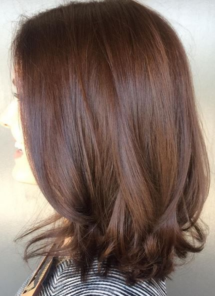 Attention all brunettes – take this picture to your colorist now! A rich, dimensional and shiny brunette shade by master colorist Amanda George.