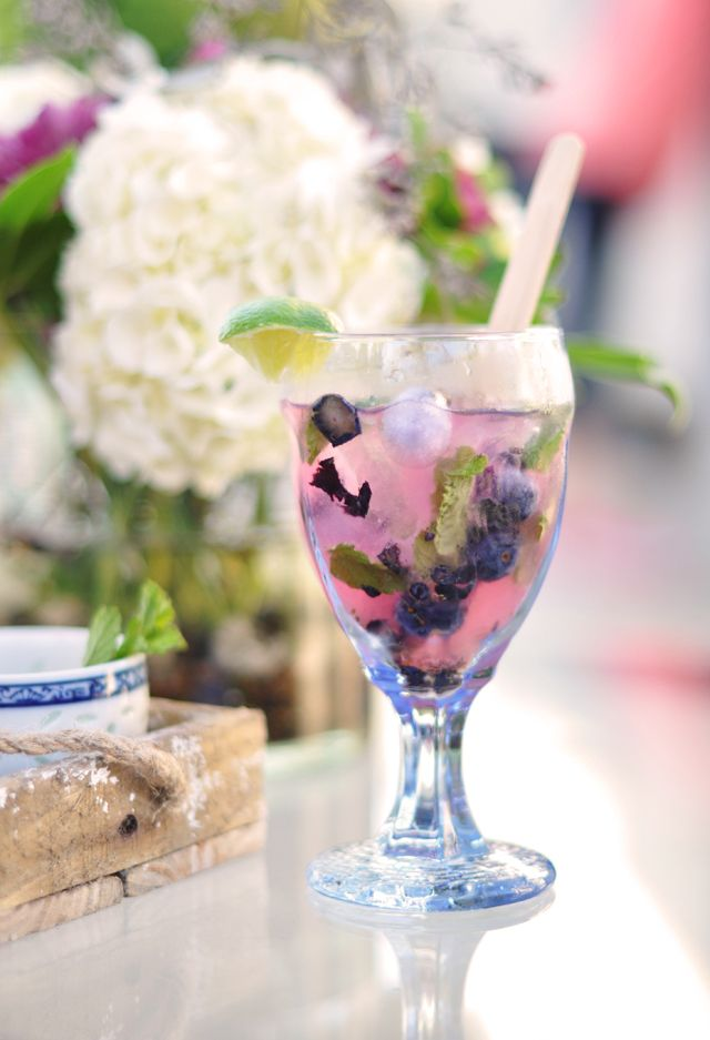 Blueberry mojitos.  Into each glass muddle or smash  5-10 mint leaves  5 fresh blueberries  2 tsp sugar  1/2 small lime, juiced     Next add   1-1/2 oz. of your favorite Rum   1-1/2 oz. of club soda.   Add ice and fruity ice to fill your glass up.