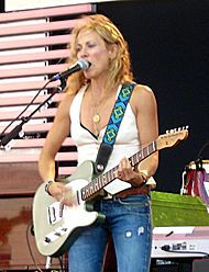Sheryl Crow - diagnosed with breast cancer in 2006 at age 44 - still rockin'