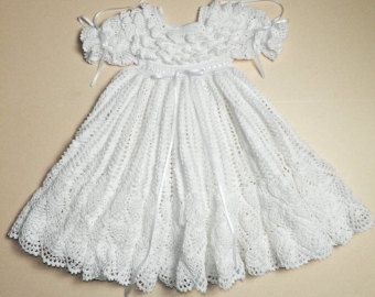 This unique Christening/Blessing dress is crocheted with #10 white cotton thread & accented with white ribbon around the waist. The bodice is unique with four rows of popcorn stitching and finished off with full puff sleeves. The skirt is extremely full with more than 2000 yards of thread. The skirt is finished with the ever popular pineapple border. This is, by far, the most intricate pattern I make and takes many hours to complete. I call this pattern Falling Leaf.  This is a beaut...