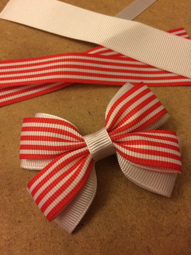 In the making, beautiful red and white striped grosgrain ribbon hair bows on alligator clips.. #hairclips #hairslides #craft #handcrafted #lovelybows