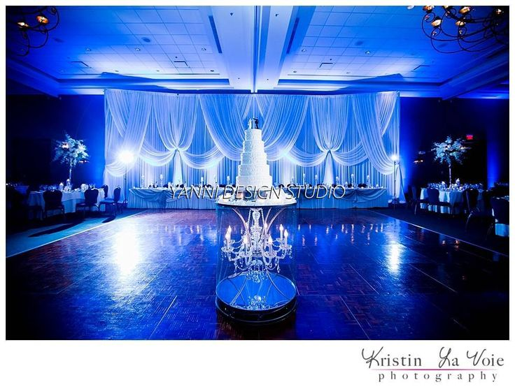 Wedding Cake And Drapes With Lights Picture Contains Cake