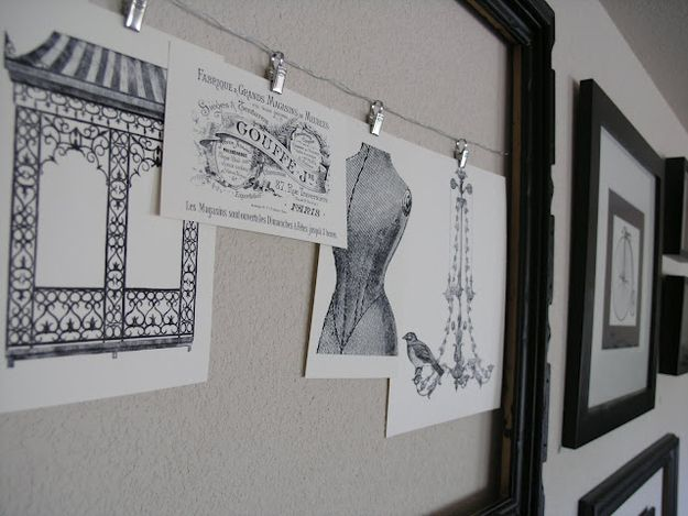Use household items to hang pictures like these curtain hangers from IKEA  http://www.ikea.com/us/en/catalog/products/60075295/