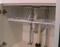 Under sink storage solutions which is easily removed in case access is needed to plumbing fixtures