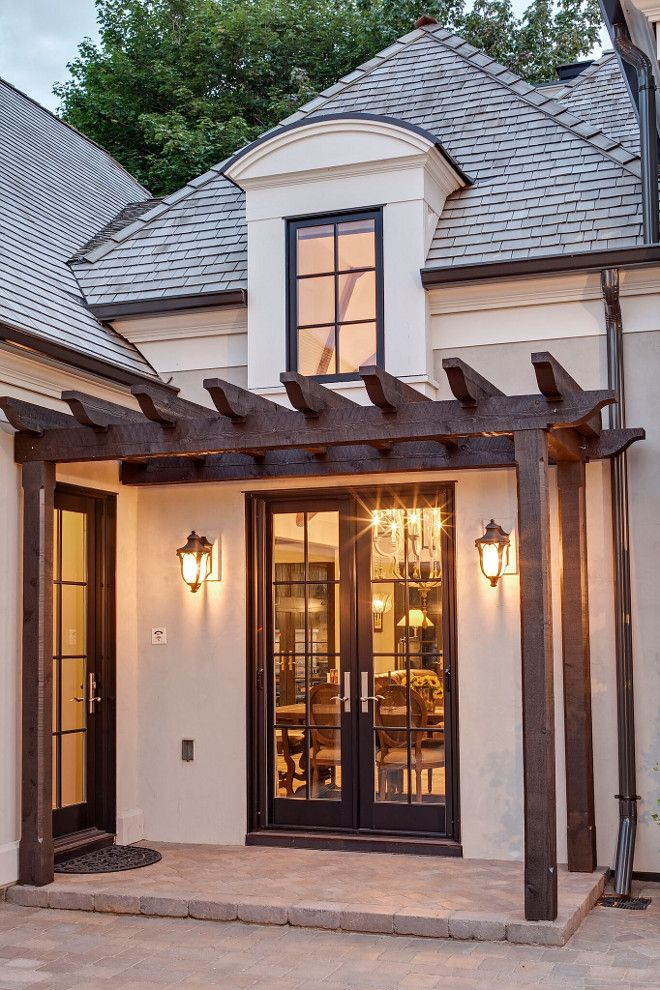Exterior Lighting and pergola. Exterior lighting is from Hinkley Lighting, Inc. #Exteriorlighting #pergola 3exteriors #homeexterior Hendel Homes