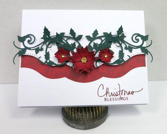 Carte de Noël belle, fabriqués à la main. Le poinsettia roux agrémenté de die et de gemmes d'or coupé vignes de houx. La carte mesure 4,25 x 5,5 (A2) et l'intérieur dispose d'un message religieux avec beaucoup d'espace pour un message d'accueil personnel.  Pour voir dautres cartes de souhaits de papillon en aluminium, visitez : www.etsy.com/shop/AluminumButterfly?section_id=11781246  Pour voir dautres produits daluminium papillon, visitez www.etsy.com/shop/Aluminumbutterfly