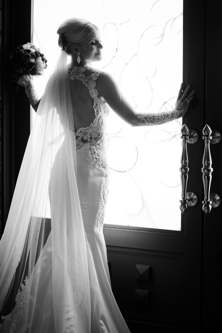 Lace Wedding Dress captured in a lifestyle wedding photograph at Chapel of the Flowers. Elegant and traditional weddings in Las Vegas.
