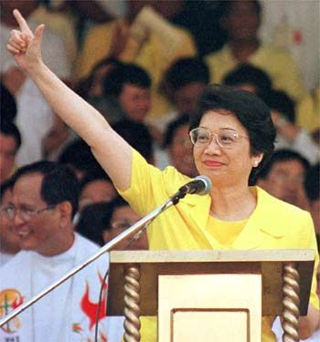"""Corazon Aquino: 1933-2009; Corazon Aquino was a Filipino politician who served as the 11th President of the Philippines, the first woman to hold that office, and the first female president in Asia. Regarded as """"The Mother of Philippine Democracy,"""" Cory led the 1986 People Power Revolution, which toppled Ferdinand Marcos and restored democracy in the Philippines. She was named Time magazine's """"Woman of the Year"""" in 1986."""