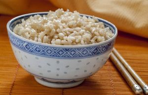 "Brown rice is the ""unrefined"" version of white rice. Before white rice went through refining , it at one time looked exactly like brown rice. Brown rice still has the hull and bran. The  hulls and brans provide ""natural wholeness"" to the grain and are rich in proteins, thiamine, calcium, magnesium, fiber, and potassium. For those trying to lose weight or those suffering from diabetes, brown rice can prove a healthful staple given its low glycemic rating which helps reduce insulin spikes."