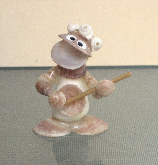 seashell crafts- this guy is kind of cute.  He looks like he is made of seashells, Millie!