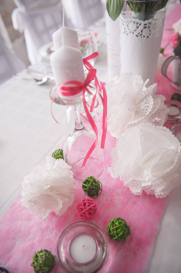 My own wedding: lace, candles and wine glasses, all in pink and green