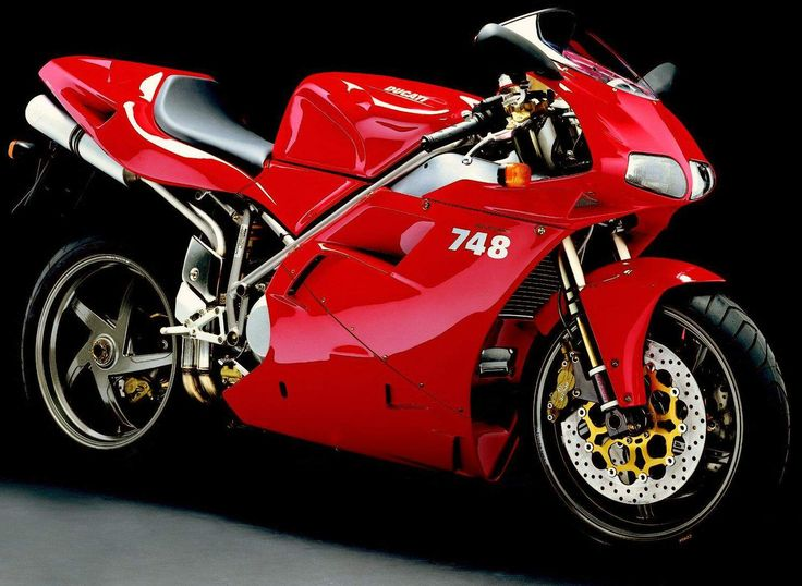 The 2001 MY Ducati 748S has, at its heart, a liquid-cooled, four-stroke, 748cc, 90-degree V-Twin cylinder powerplant mated to a six-s...