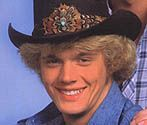 John Schneider was born in New York in 1960.  He moved to Georgia when he was a young boy and made his first film appearance as a cowboy in the crowd in the film Smokey and the Bandit in 1977.  He starred in several TV shows but got his big break and launch into stardom as 'Bo Duke' in The Dukes of Hazzard in 1979...  Read more>>