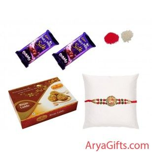 Send the best Rakhi wishes to your dearest brother and show how much you will miss them on this Raksha Bandhan. Designer crystal Rakhi with Besan Laddu 500gm and 2 Cadbury Dairy Milk Silk Bubbly(50 gm).Rakhi design may differ as per the stock available. We offer free pack of Roli & Chawal along with Rakhis.