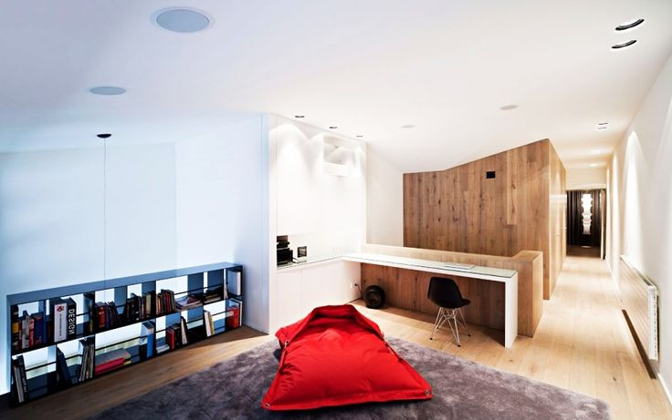 Home Design, Awesome Vivienda En Arnedo Home Seating Space With Comfy Rug Completed With Red Throw Pillow And Bookcase: Fantastic Modern Contemporary House Design Ideas With Monochrome Theme