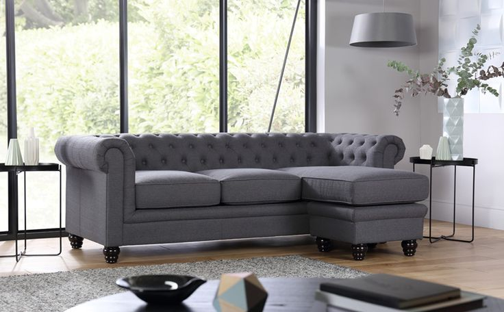 <p>With elegant scroll arms, a deep buttoned backrest and turned wooden legs, the beautifully-crafted Hampton has all the traditional features you expect from a classic Chesterfield, but with a contemporary twist – a sumptuous high-quality linen-look fabric covering.</p> <p>It's upholstered with durable thick weave fabric in cool slate that's great to touch and easy to care for. The solid wood frame, deep-tufted back and arms, and pocket sprun...