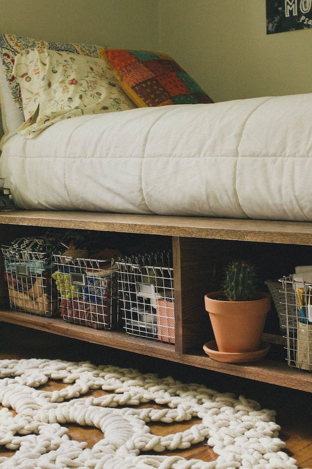 platform bed & storage & metal baskets.