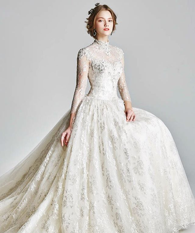 This high-necked wedding dress shows a timeless silhouette ...