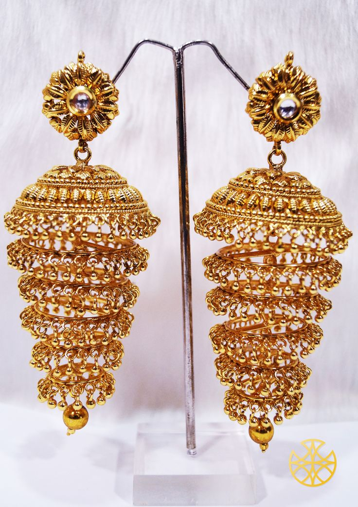If you have a slightly rounded face or curved features go for such long jhumkas with kundan tops. They've got to suit you just right!   Follow us on Instagram: instagram.com/malanajewels/   Like us on Facebook: www.facebook.com/malanajewels   To buy, please mail us on info@malanajewels.com with your requirements or call us on +91 9820302982.