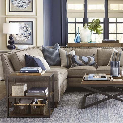 Large L-Shaped Sectional from Bassett. Loose back cushions, distinctive padded roll over arm and distinguishing tapered legs!