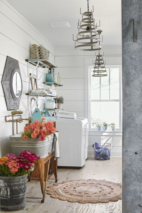 Something Galvanized:  Like the bucket and the jar-drying rack chandeliers seen in this laundry room/mudroom.