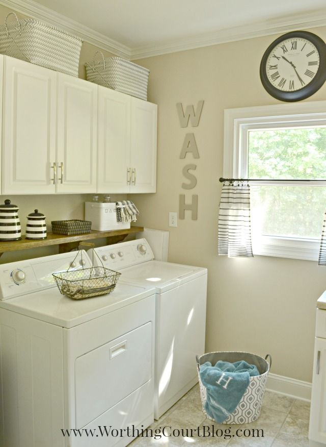 Laundry room with farmhouse and rustic touches.  Love the cabinets, as well as the shelf above the washer & dryer