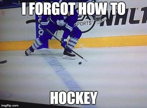 Ladies and gentlemen, I present to you the Toronto Maple Leafs' Tim Gleason playing the puck with the wrong end of his stick.