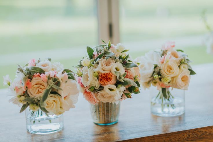Have some vases ready with a little water (not too much) to put your bouquets in during the reception/dinner. Photo by Benjamin Stuart Photography #weddingphotography #whitehorseflowercompany #weddingbouquets #vases #weddingflowers
