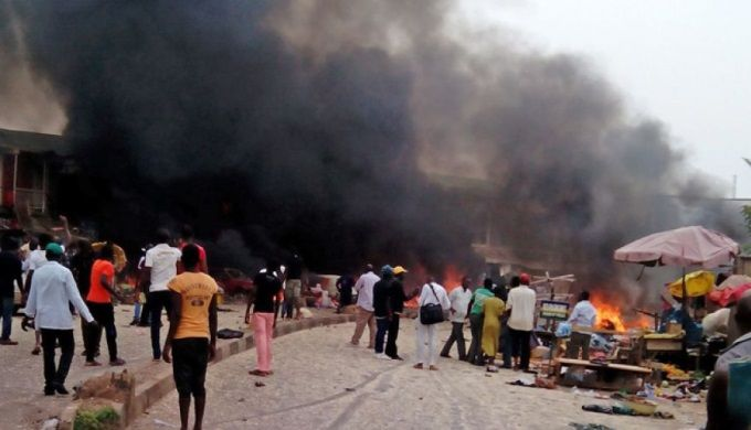 At least 118 people were killed and dozens more injured when two car bombs exploded at a busy bus terminal and market in Nigeria's central city of Jos on Tuesday.