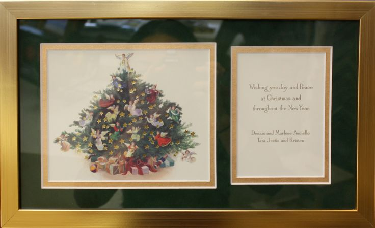 Decorative Christmas card preserved throughout the year in a bright gold frame with a matching inner gold mat border.  Designed and framed at Art & Frame Express in Edison NJ