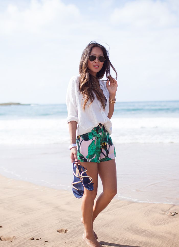 Truffol.com | Loose white shirt, sandals, gold aviators + patterned shorts. #jetsetter #beach #explore #style #vacation