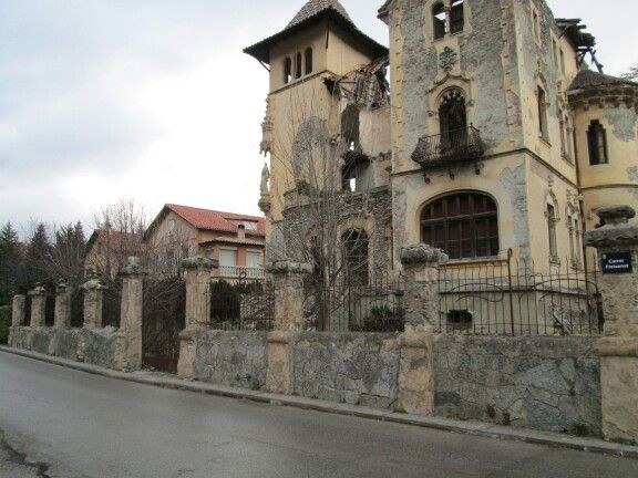 spain, camprodon - derelict church beside modern home