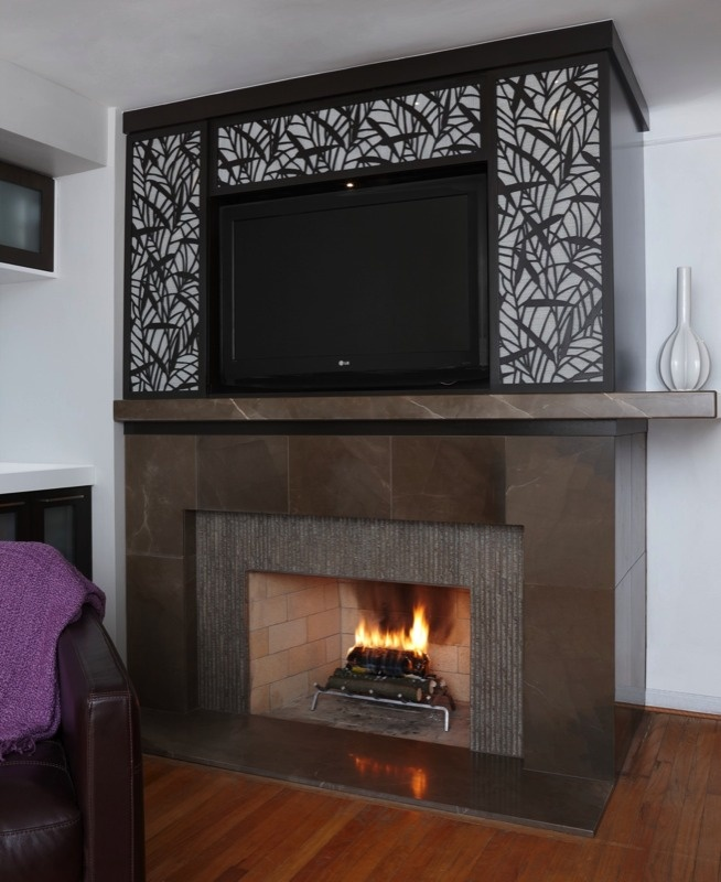 A beautiful enclosure for a flat screen tv mounted above a for Motorized tv mount over fireplace
