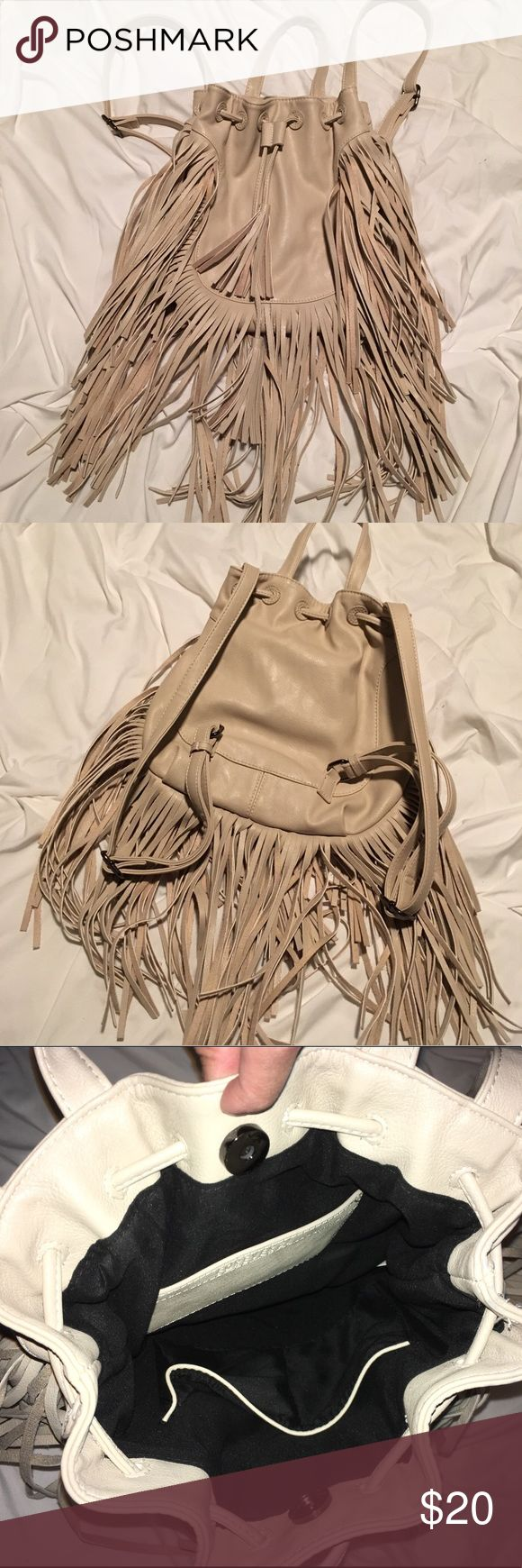 Fringe Mini Backpack Mini backpack! Perfect for festivals, amusement parks, outings, etc. Perfect condition! Magnetic closure. Last picture is me wearing. (Sorry it's only a side view lol) Forever 21 Bags Backpacks