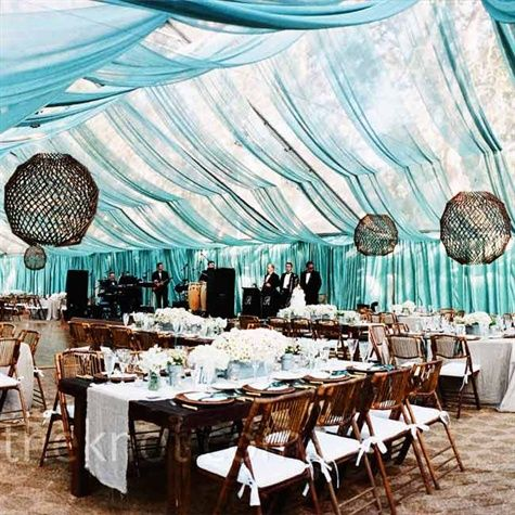 Clear tent with transparent teal fabric draped from ceiling....how pretty!