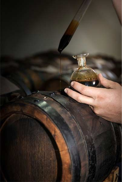 Transfer of Balsamic Vinegar of Modena from Barrel to Bottle, Italy